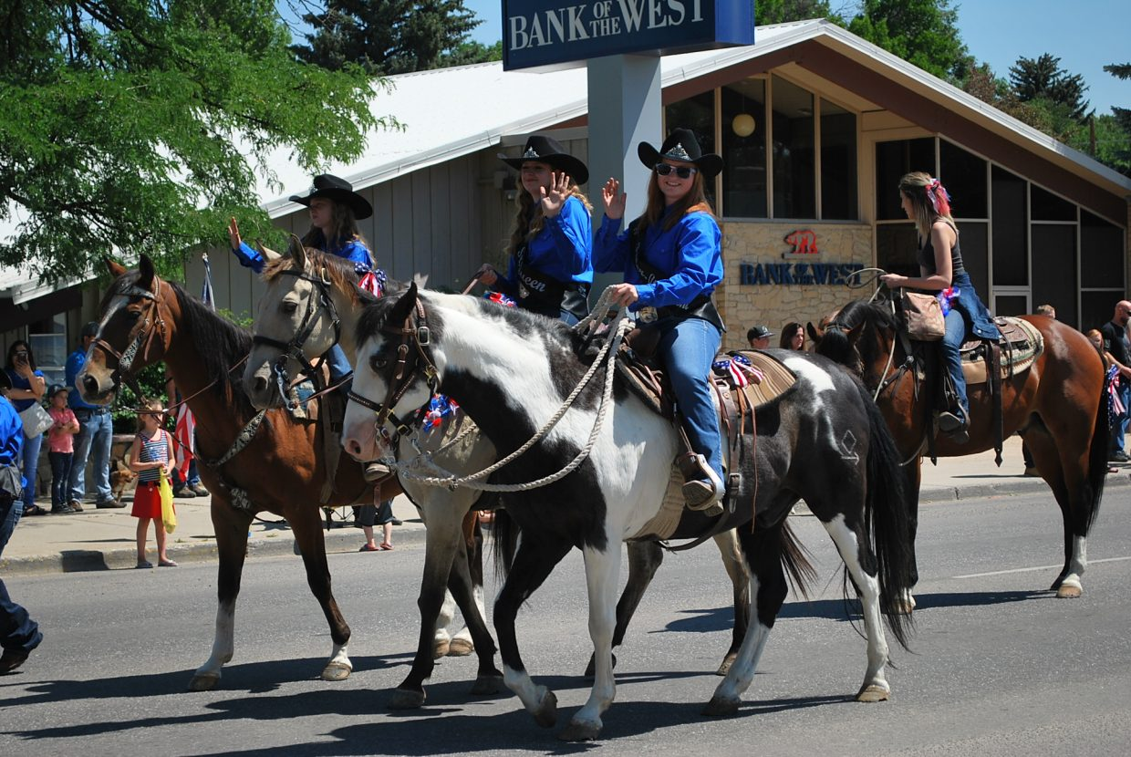 Rodeo queens rode into town giving their best smile and waves.