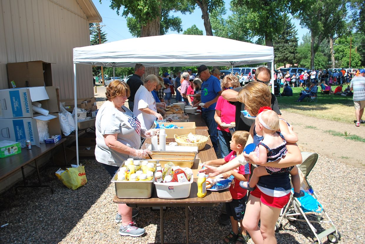 After the parade, the Craig Veterans of Foreign Wars served hotdogs and hamburgers to a large crowd.