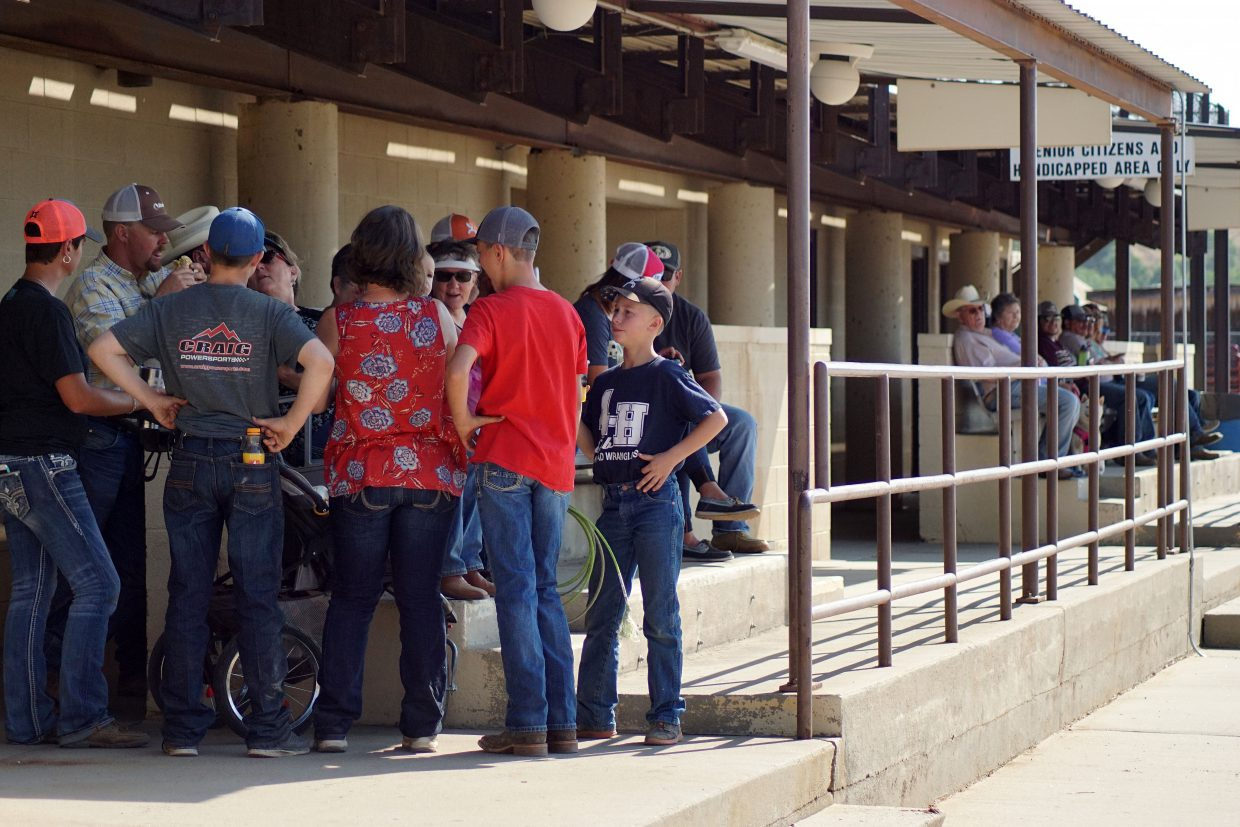 A crowd gathers before the races. Attendees may or may not have placed a few side bets.