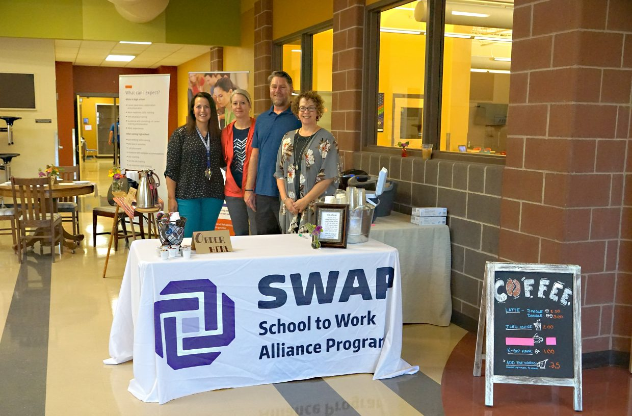 A coffee bar, provided by SWAP —School to Work Alliance Program — allows educators the option of buying coffee with their breakfast. Pictured, from left, are SWAP Coordinator Amanda McDermott; Annie Sauer, from the Division of Vocational Rehabilitation; and special education instructors Jeff Sullivan and Amy Ulrich.