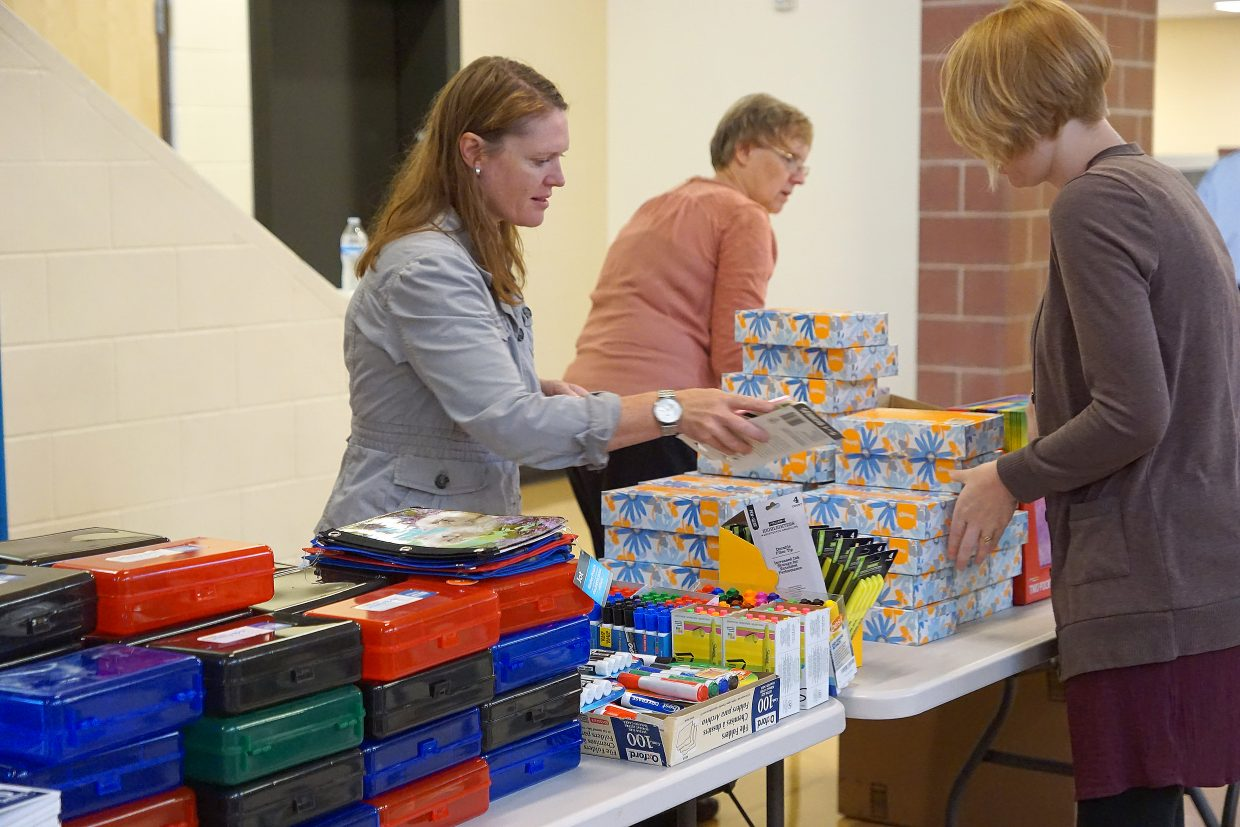 Educators select from a variety of school supplies.