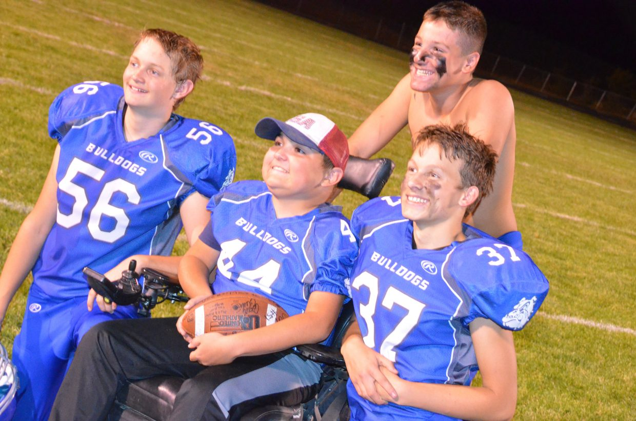Craig Middle School's JP Price center, is joined by friends and teammates Tristan Malvitz, Spencer Najera and Darby Byrnes.