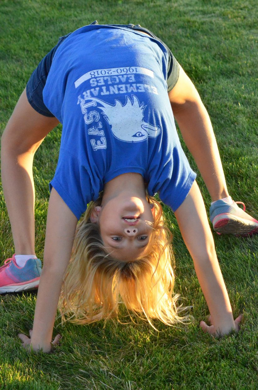 Joslyn Price shows her flexibility as she awaits the second half of Craig Middle School's football game Tuesday.