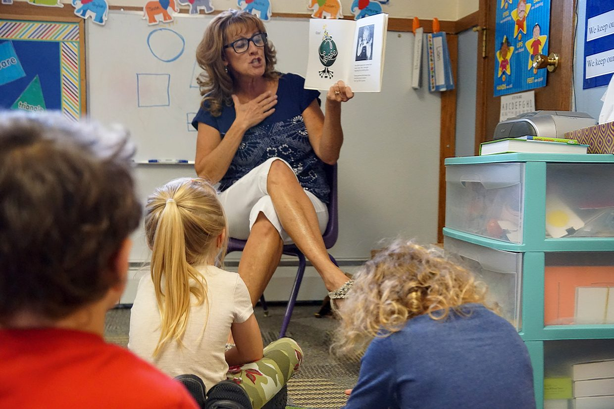 Eagle's Nest Preschool Director and Teacher Angie Roberts reads a book about germs.