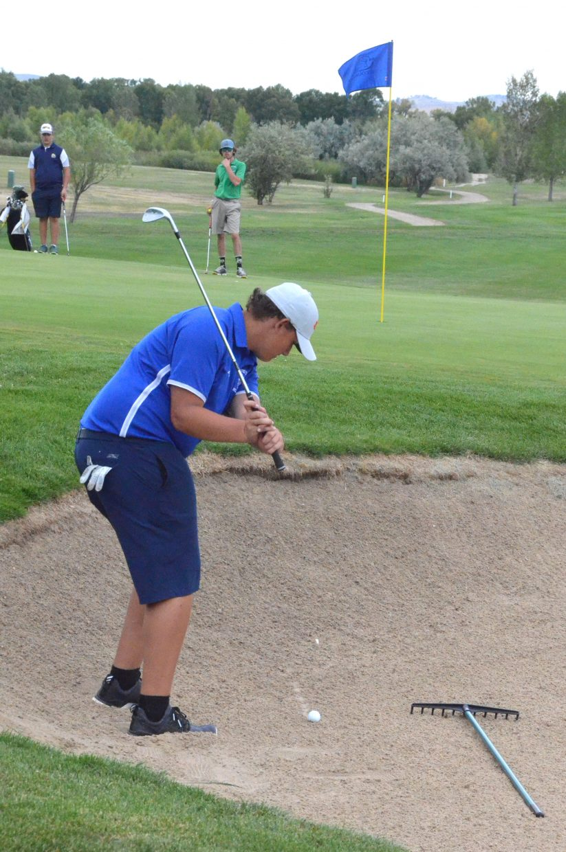 Moffat County High School's Dave Andujo looks to get out of the sand Wednesday near Yampa Valley Golf Course's 18th green during the MCHS Invitational.