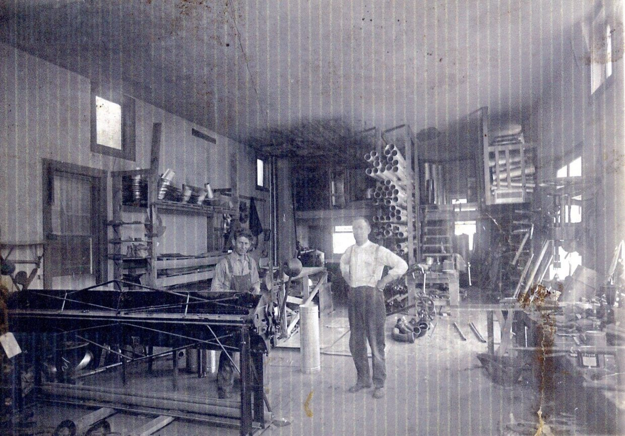 This photo shows the interior of the building on the northwest corner of Breeze Street and Victory Way. This is the building were Mark Shepherd, on the right, worked his first job with C.J. Kennedy, on the left, in the basement of the Pleasant Building. Walter Smith Grocery was upstairs, and the plumbing store was downstairs. Later, Shepherd Plumbing opened on Russell Street.