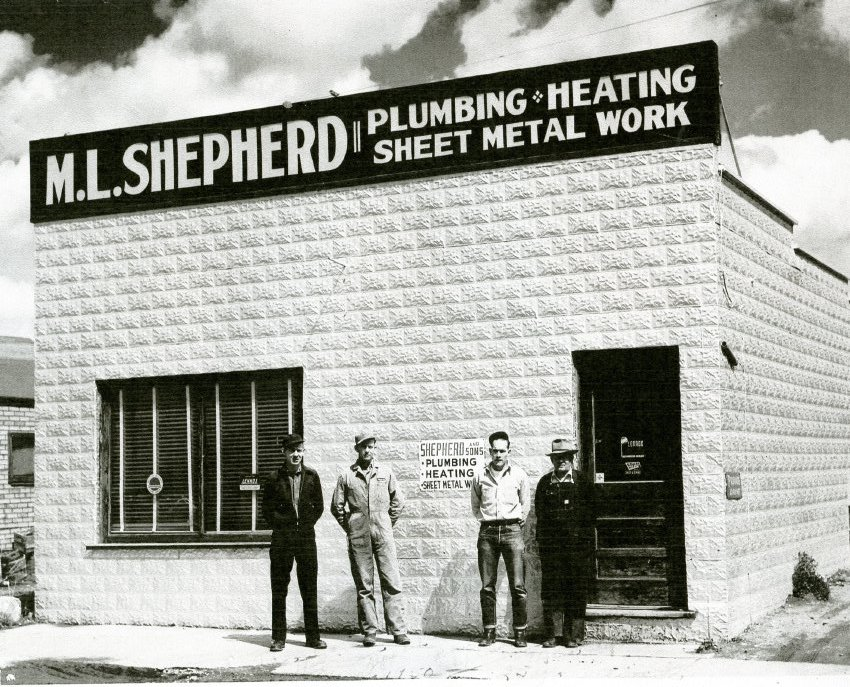 A photocopy of a photograph of M.L. Shepherd Plumbing and Heating, Sheet Metal Work on Russell Street, marking the 25th anniversary of the business. Pictured, from left are James Shepherd, Sam Lippard, Robert (Bob) Shepherd and Mark L. Shepherd.