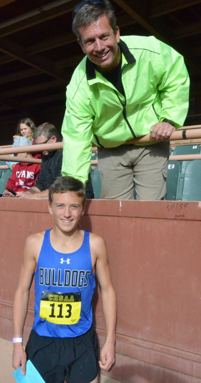 Colt Mortenson congratulates son and Moffat County High School cross country runner Wyatt Mortenson on his finish at the CHSAA State Championships in Colorado Springs.
