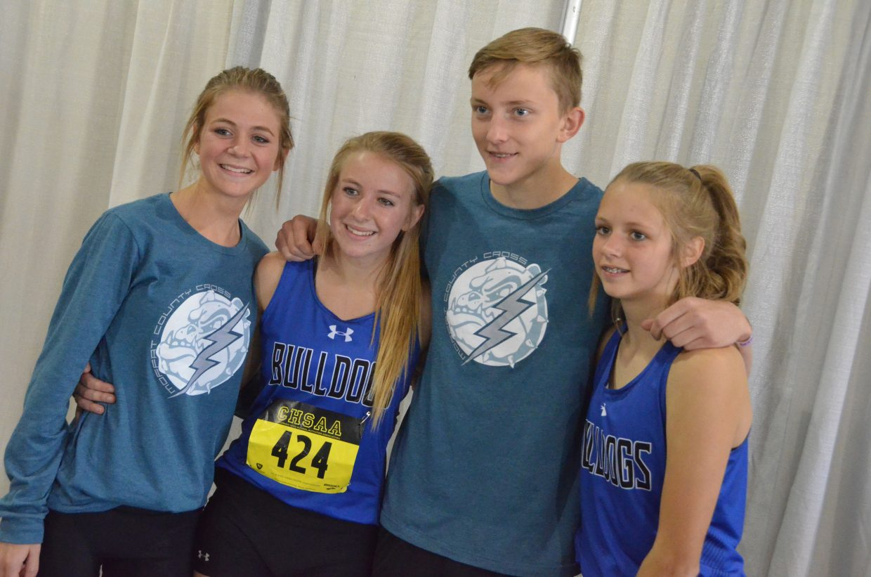 From left, Moffat County High School's Liberty Hippely, Halle Hamilton, Logan Hafey and Emma Jones gather following the CHSAA State Championships in Colorado Springs.