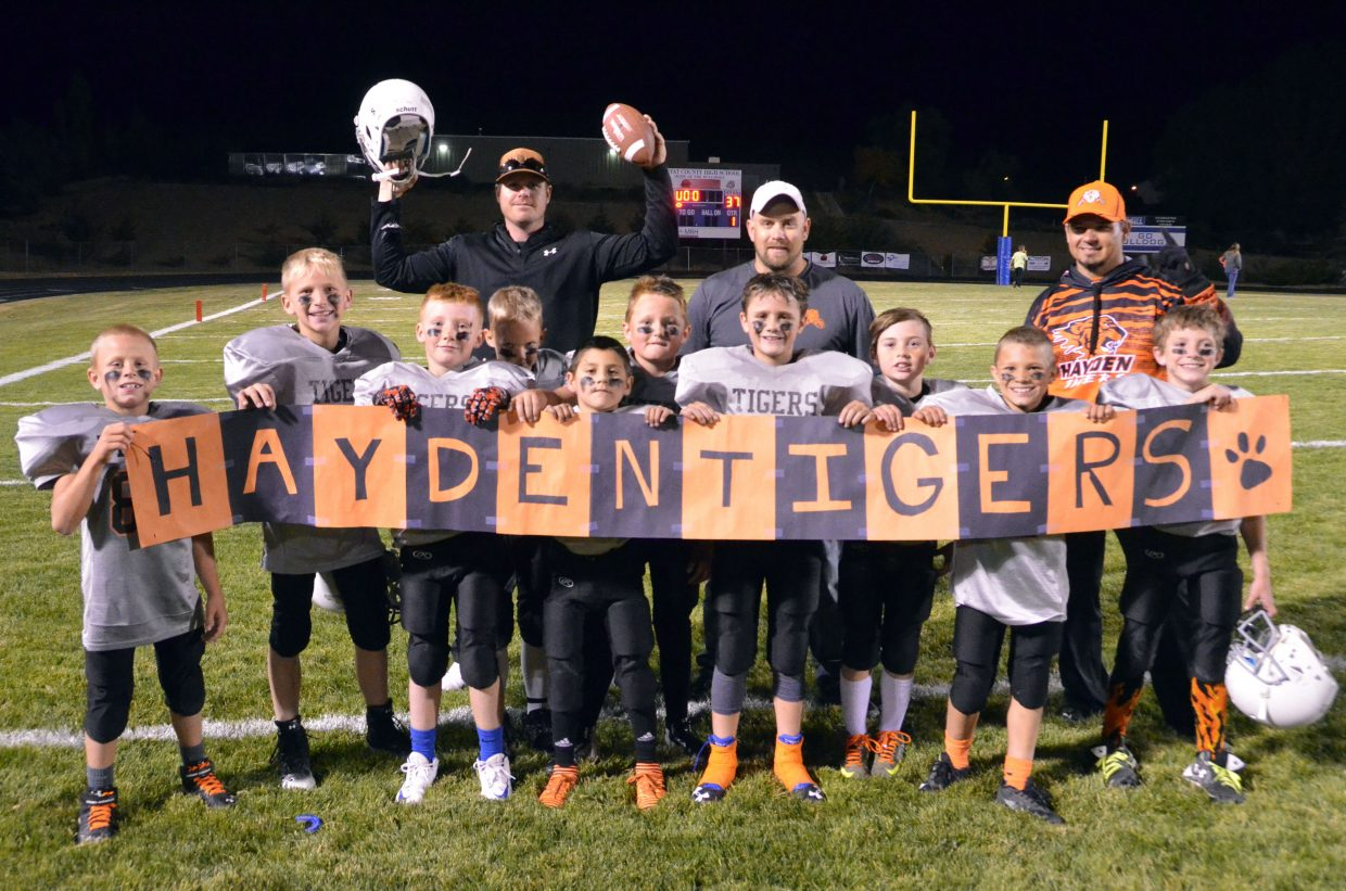 The players and coaches with Hayden Tigers celebrate their win of the championship game Sept. 26 for Doak Walker third- and fourth-grade tackle football.