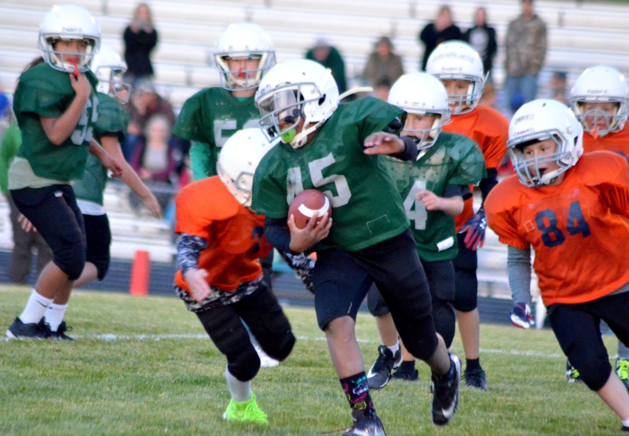 The Jets' Linda Warrior breaks loose from the Bronco defense during the Craig Parks and Recreation Doak Walker playoffs.