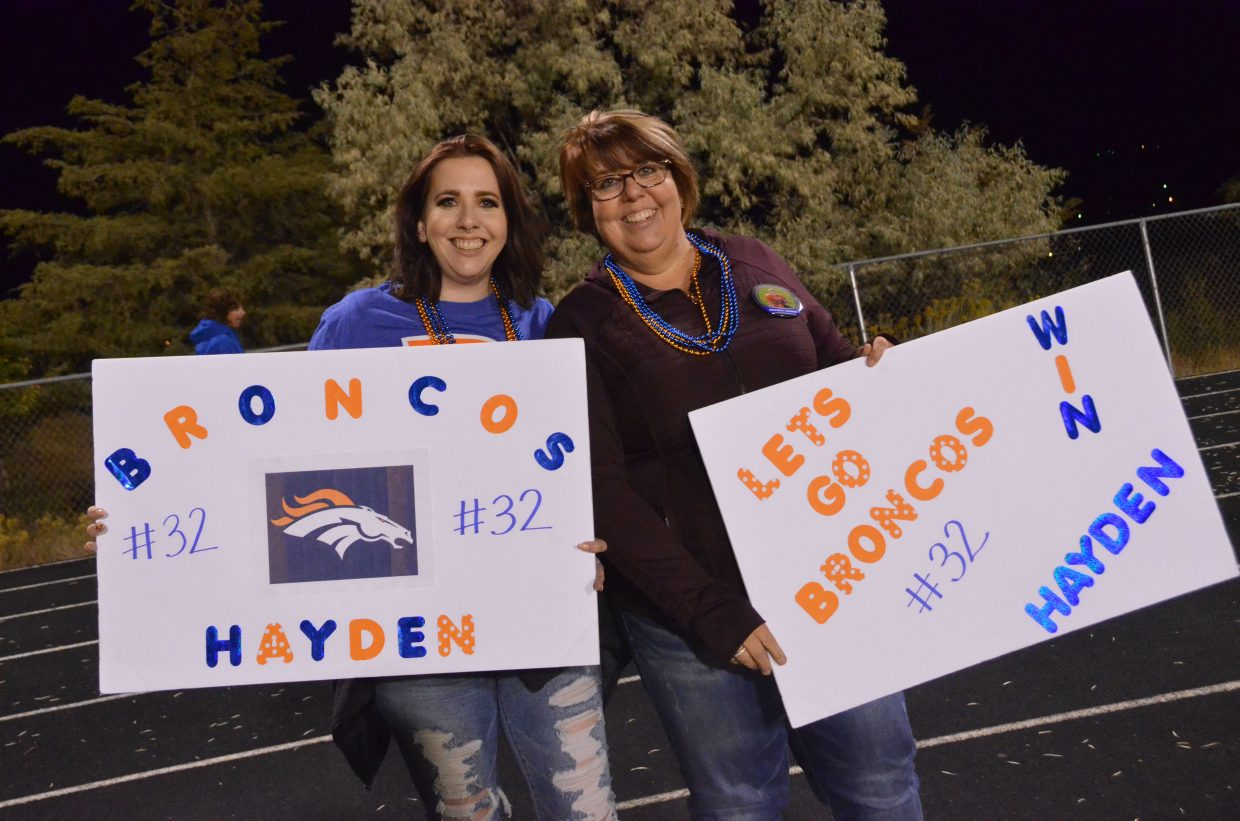 Ashley Segraves and Kathy Lowrey cheer on the Broncos The Broncos' Colt Call takes a hop to avoid a tackle during the Craig Parks and Recreation Doak Walker playoffs.