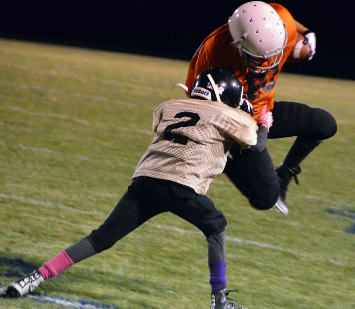 The Broncos' Colt Call takes a hop to avoid a tackle during the Craig Parks and Recreation Doak Walker playoffs.