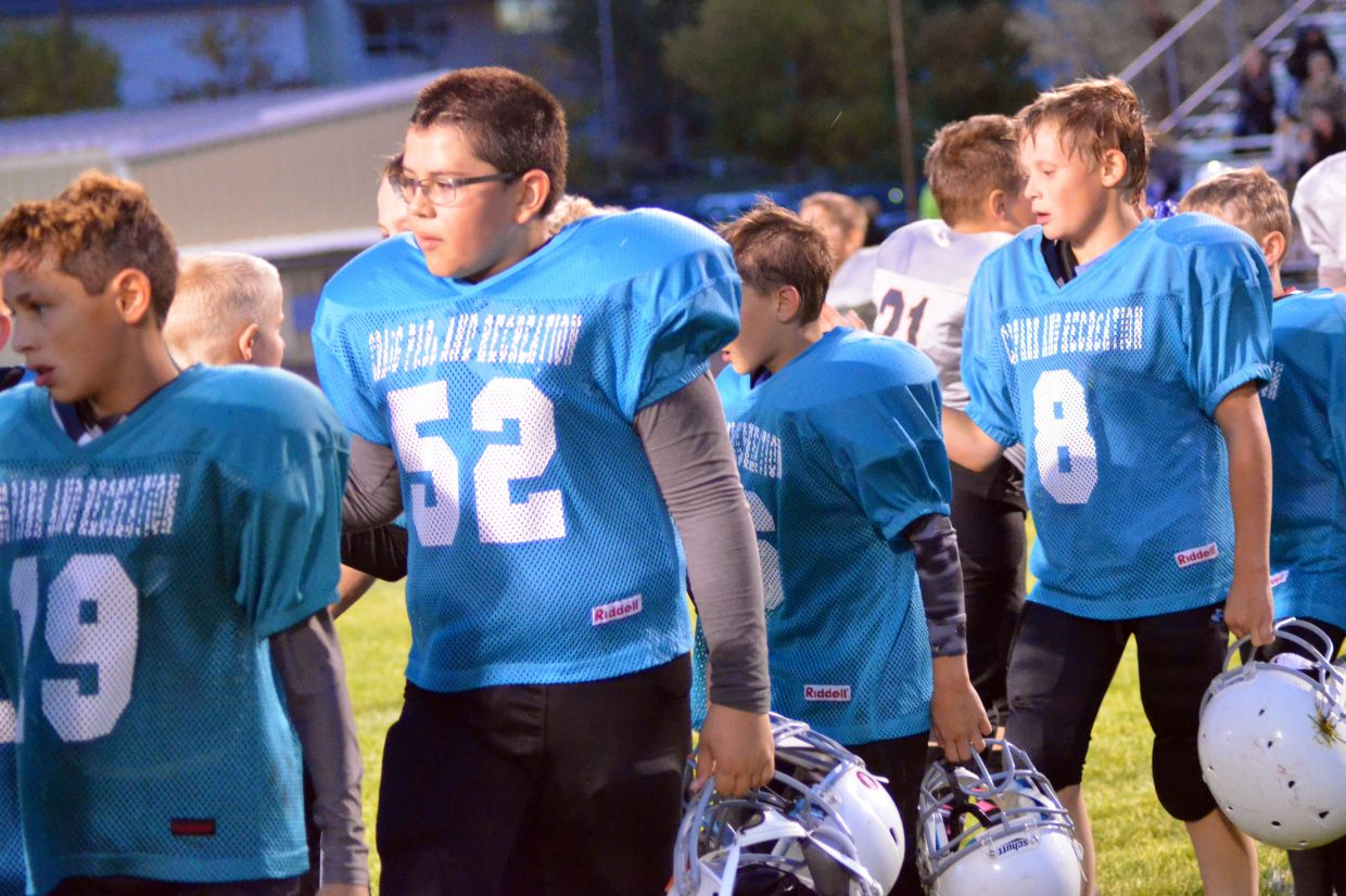 Members of the Dolphins congratulate Hayden players on a good game during the Craig Parks and Recreation Doak Walker playoffs.