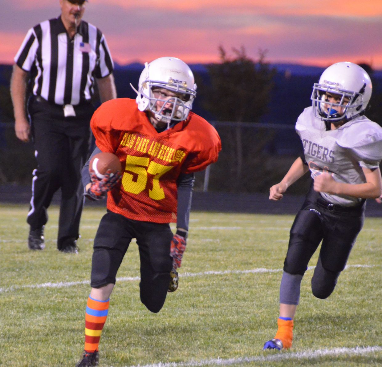 Chiefs quarterback Tanner Musgrave keeps the ball and makes a move against Hayden during the Craig Parks and Recreation Doak Walker playoffs.