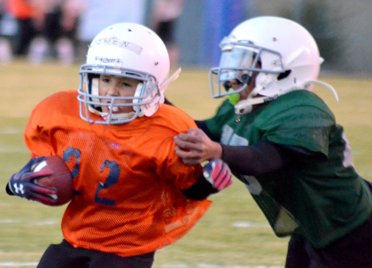 The Broncos' Owen Hill looks for a little more yardage during the Craig Parks and Recreation Doak Walker playoffs.