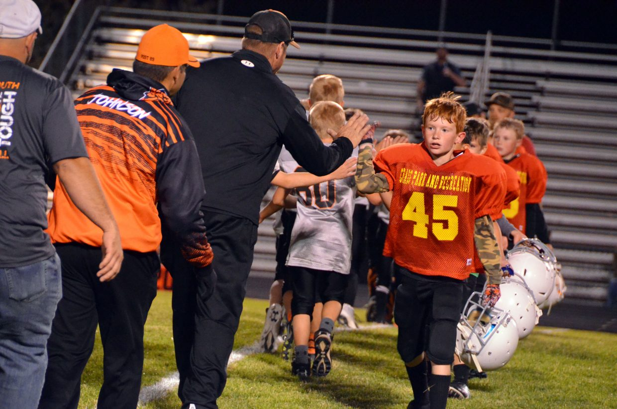The Chiefs and Tigers exchange high-fives following the Craig Parks and Recreation Doak Walker championship game.