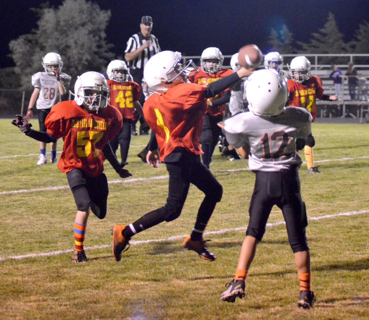 The Chiefs' Reece Weston leaps in for a possible interception against Hayden during the Craig Parks and Recreation Doak Walker playoffs.