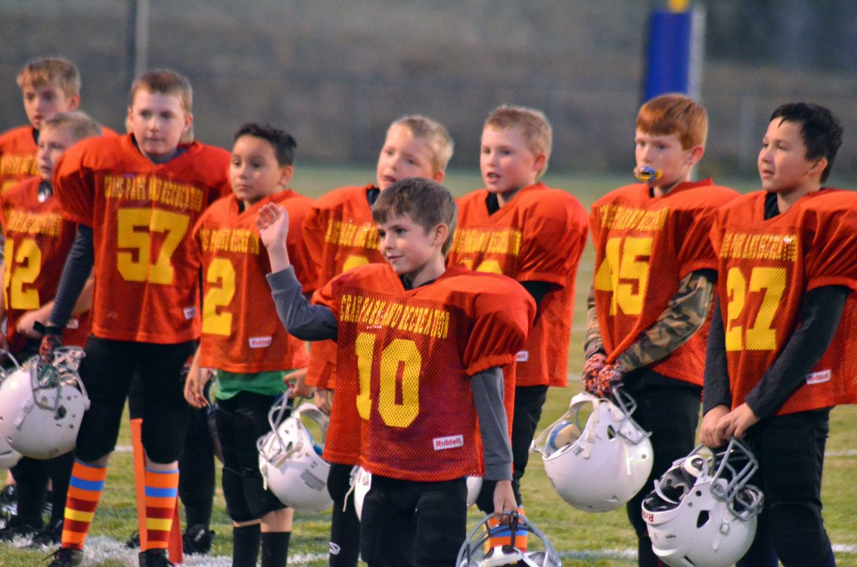Members of the Chiefs greet the crowd as part of pre-game introductions during the Craig Parks and Recreation Doak Walker playoffs.