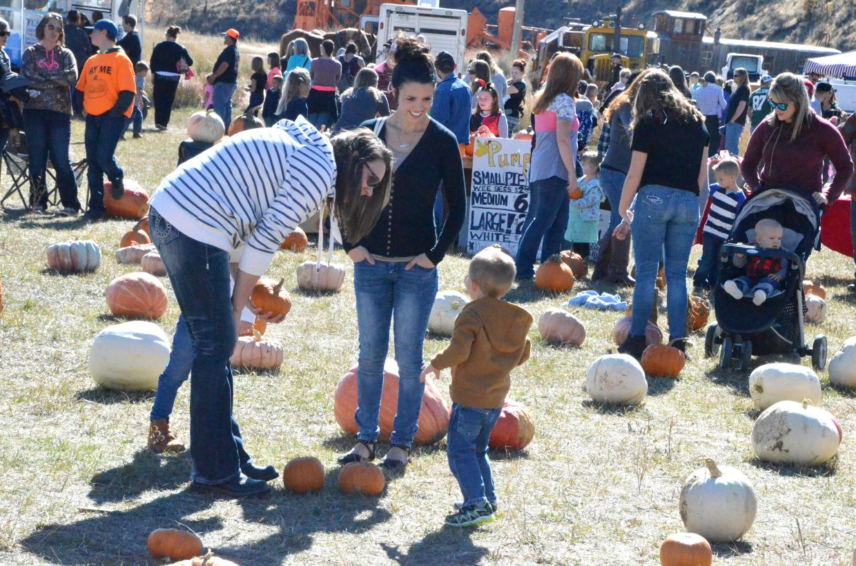 Kids and parents enjoy the day at Saturday's pumpkin patch at Wyman Living History Museum.