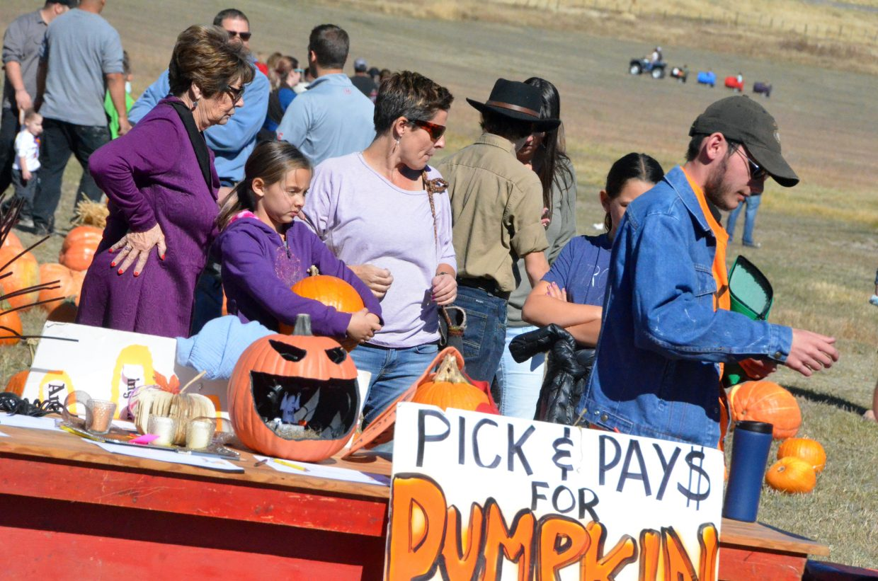 Customers await to pay for their picks at Saturday's pumpkin patch at Wyman Living History Museum.