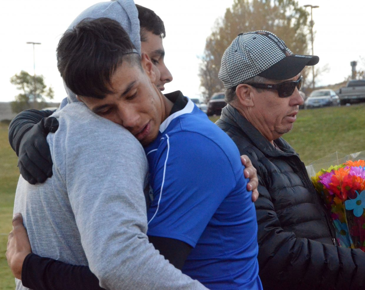 Moffat County High School's Axeel Mendoza hugs older brother Tracy during a halftime ceremony for Senior Night for MCHS boys soccer.