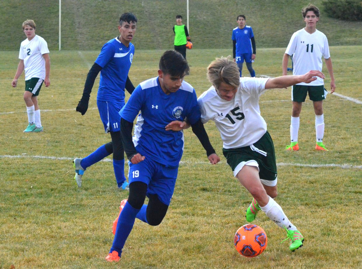 Moffat County High School's Christian Orona works for a steal  against Colorado Rocky Mountain School.
