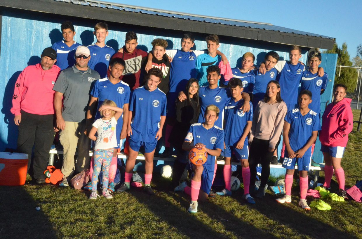 Moffat County High School soccer players, coaches and managers show their pink apparel after the Pink Game with Roaring Fork.