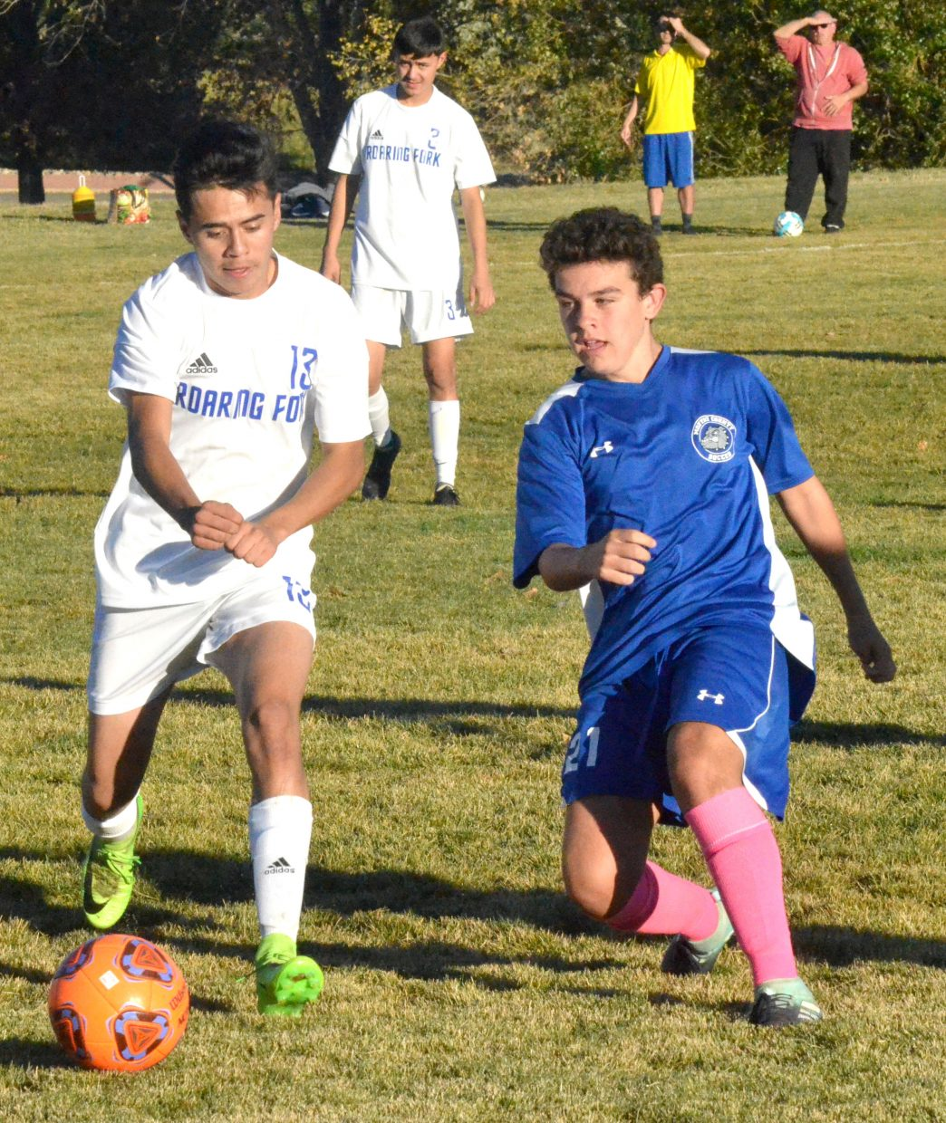 Moffat County High School's Guillermo Estecha boots a pass to teammates downfield.