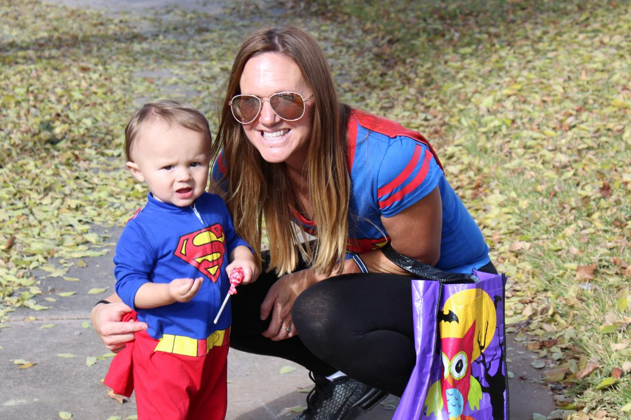 Aiden Serna, left, who just turned 1 year old, has a super time on his first Halloween with mom Michelle Welch. The two were enjoying a beautiful day Saturday during Yampa River State Park's Hike or Treat event.