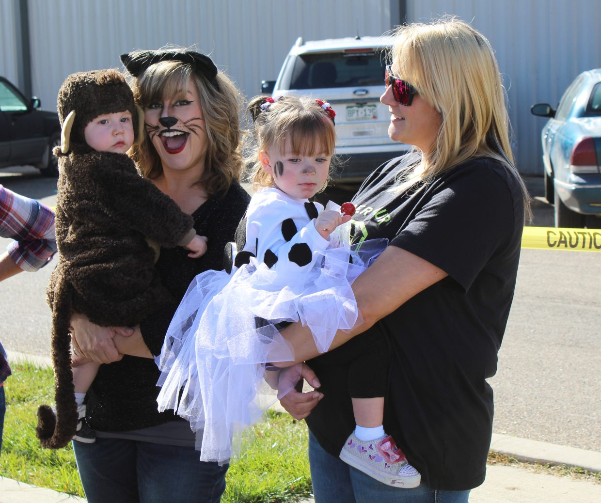 Linda and Jacob Foulk, left, and Chantae and Paisley Abney show off their costumes during the Trunk or Treat event, held Saturday at Thunder Rolls Bowling Center. A Rock-N-Bowl Halloween party followed Saturday evening.