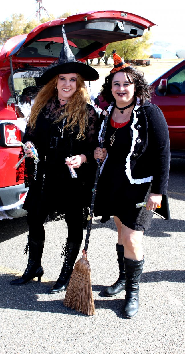 Jennifer Borlean and Adrianna Robbins get in the spirit of Halloween Saturday during the Trunk or Treat event at Thunder Rolls Bowling Center.