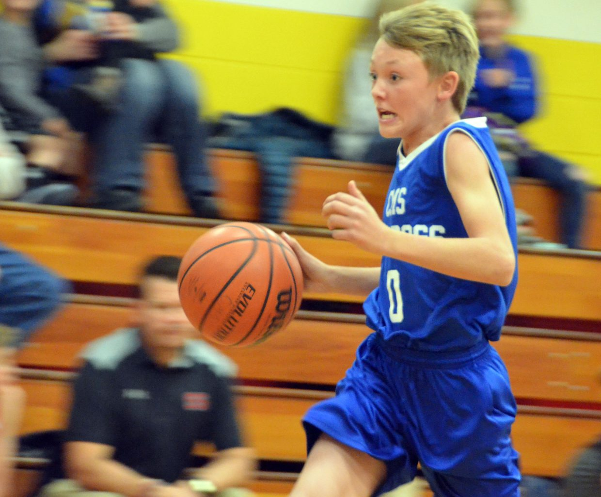 Craig Middle School's Kenny Fredrickson surges alone toward a score on a fastbreak against Steamboat Springs.
