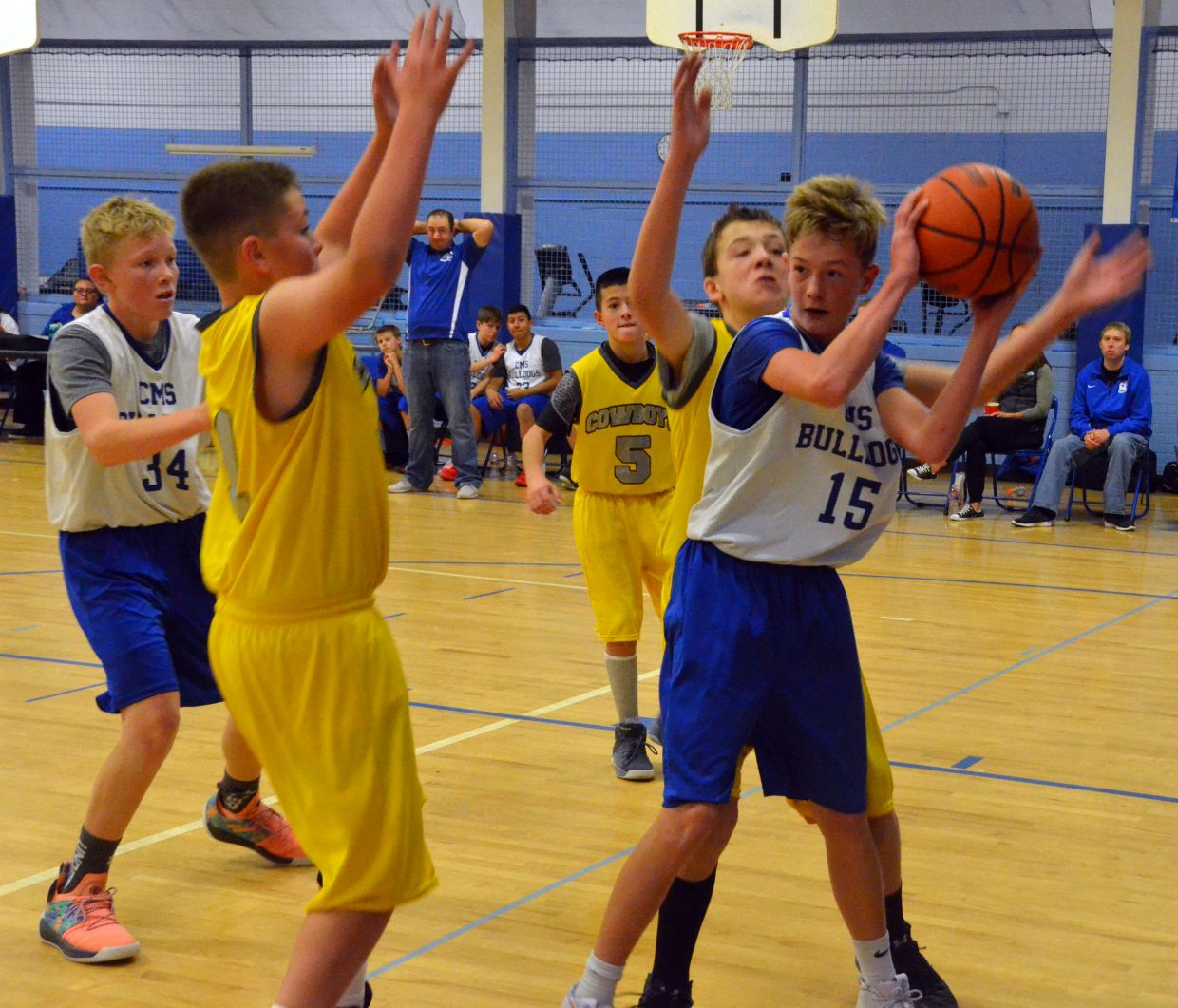 Craig Middle School's Evan Beaver is double-teamed by Meeker opponents.