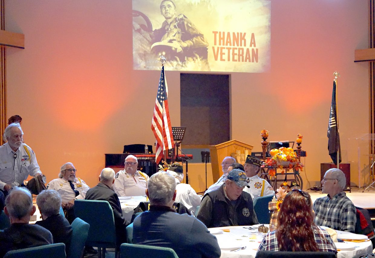 A slide show honoring veterans was part of an early Thanksgiving dinner hosted by the Lighthouse of Craig on Sunday.