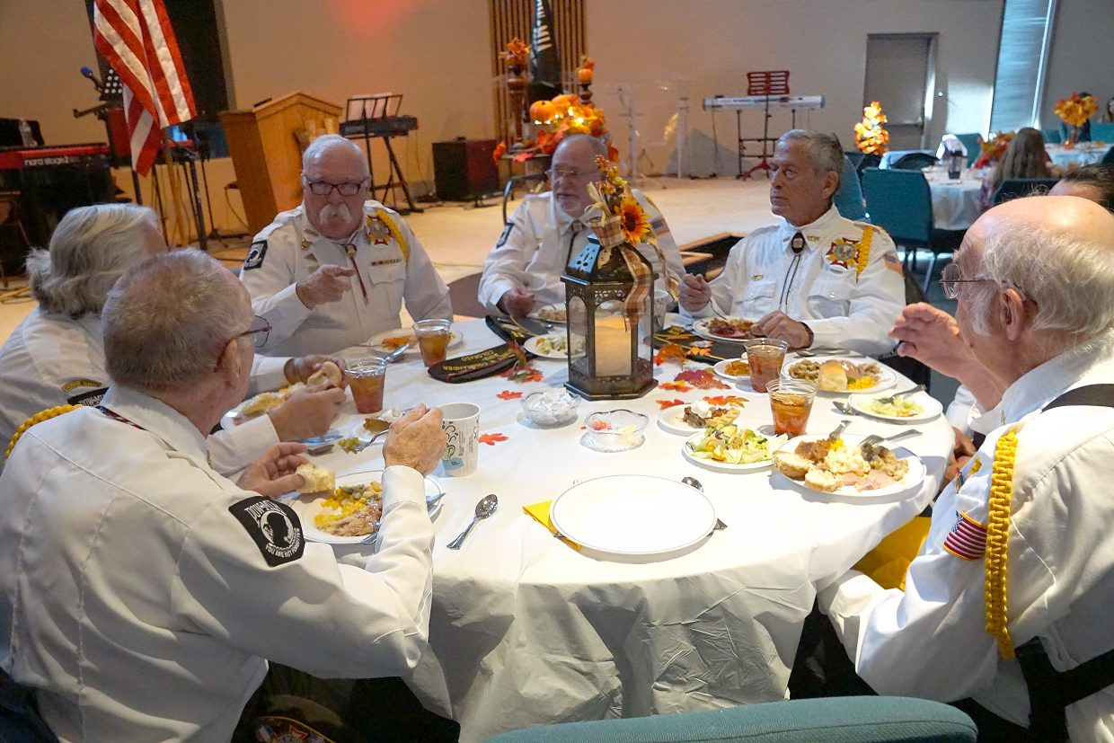 Members of the Veterans of Foreign Wars Craig Post 4265 color guard prepare to enjoy Thanksgiving dinner at the Lighthouse of Craig on Veterans Day, Sunday, Nov. 11.