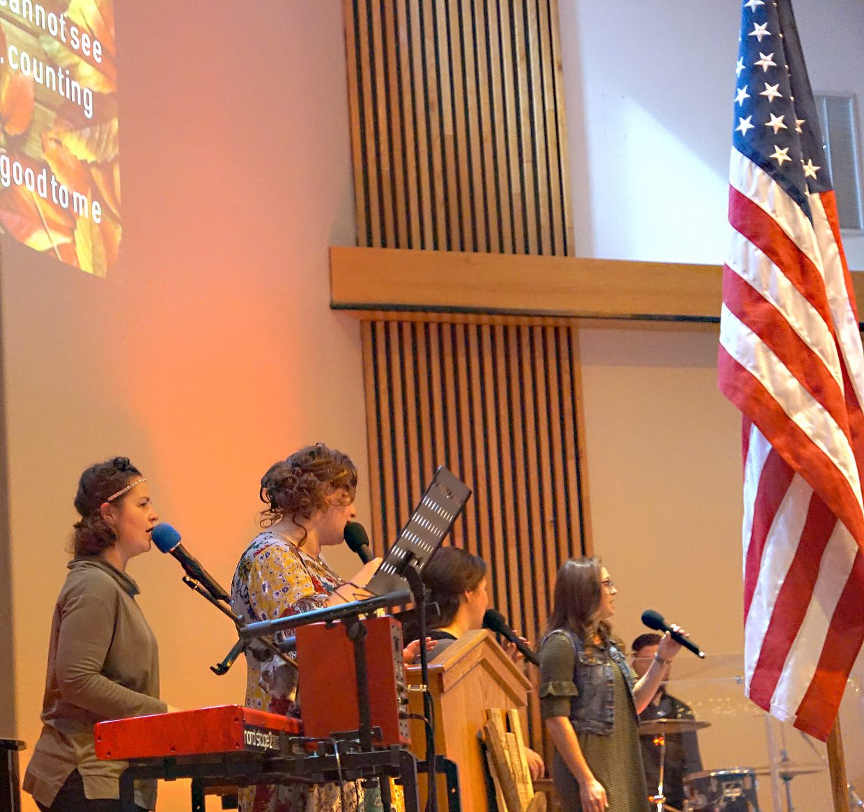 The Lighthouse of Craig singers perform during an early Thanksgiving dinner Sunday in honor of veterans..