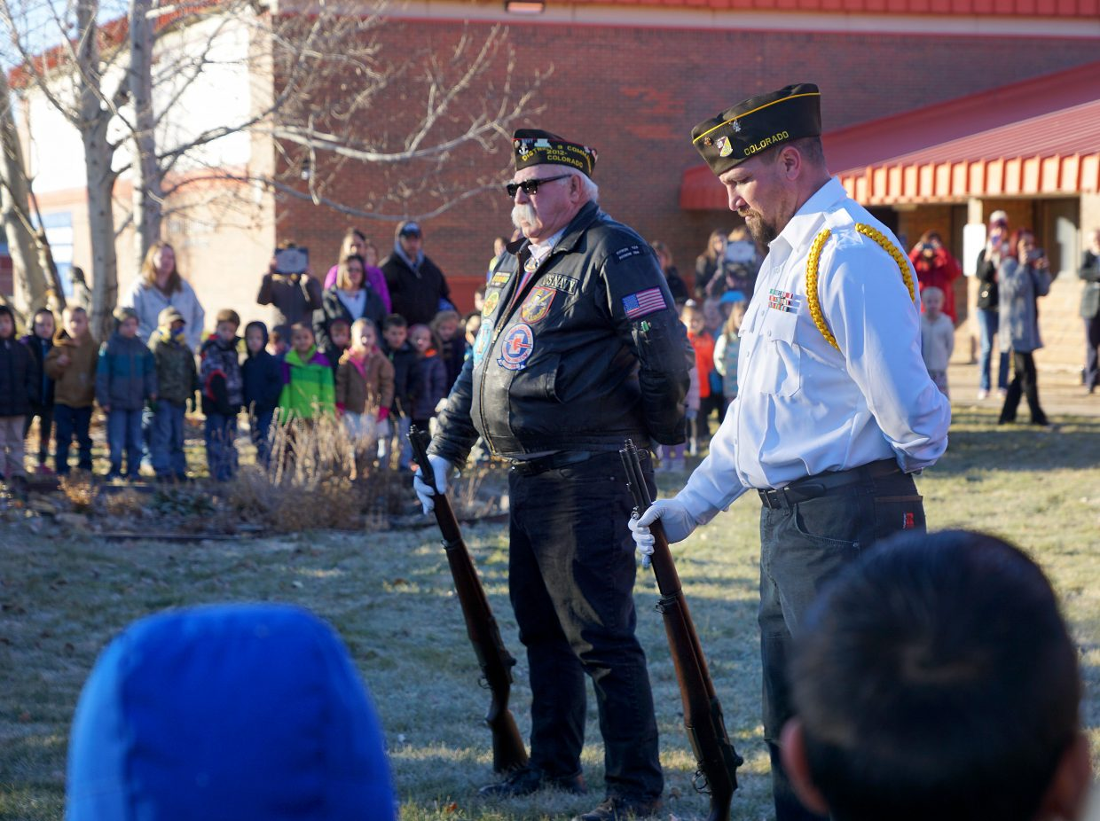 VFW Color Guard stand ready during the flag raising ceremony at Sunset Elementary School.