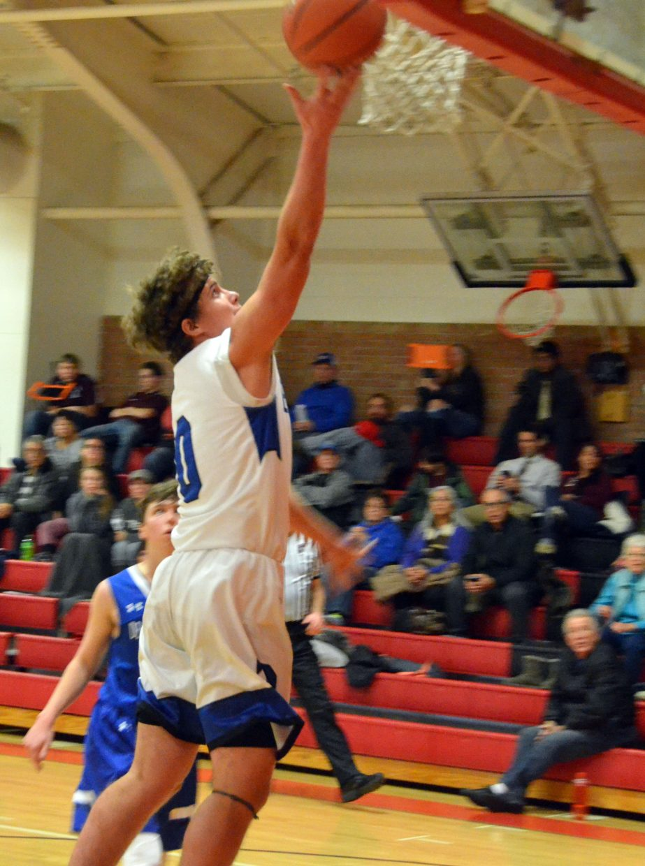 Moffat County High School's Cale Scranton beats any coverage with a layup against Denver Christian.