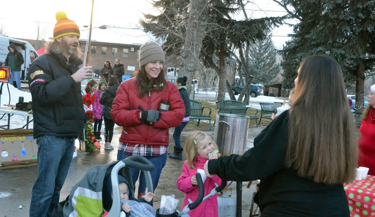 Families enjoy cookies, hot chocolate and more during Down Home Christmas Saturday in Alice Pleasant Park.