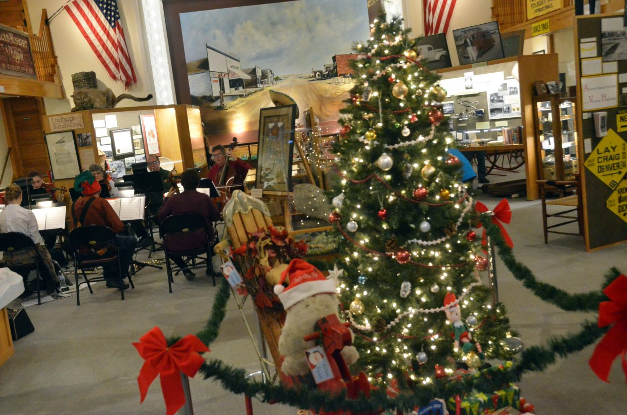Musicians with Cedar Mountain Strings Ensemble and Cedar Mountain Brass perform during Down Home Christmas Saturday at Museum of Northwest Colorado.
