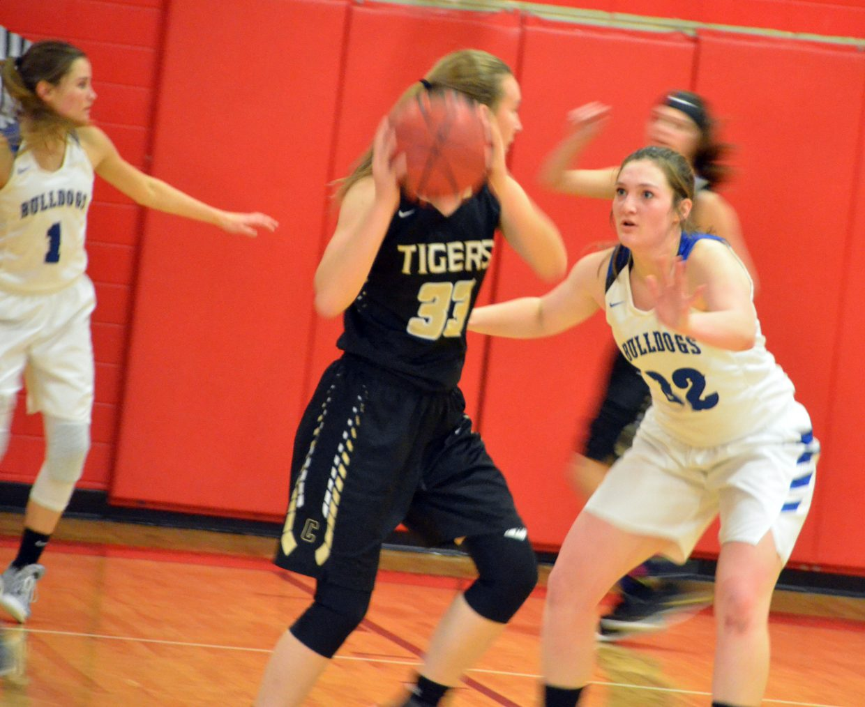 Moffat County High School's Stephenie Swindler, left, and Tiffany Hildebrandt stay moving on defense against Cañon City.