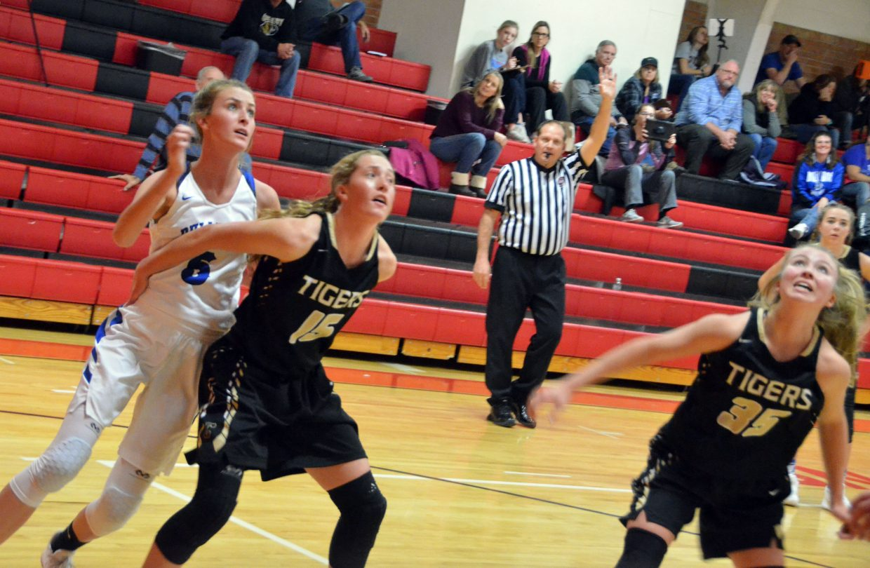 Moffat County High School's Kinlie Brennise struggles to avoid the boxout by Cañon City.
