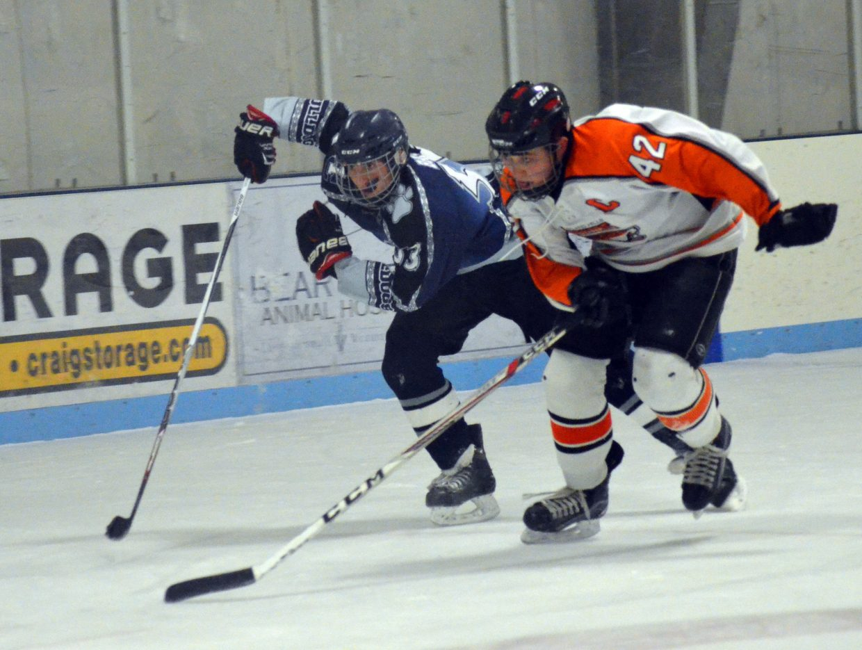 AJ Barber races after the puck during Moffat County Bulldogs' game against Hyland Hills.