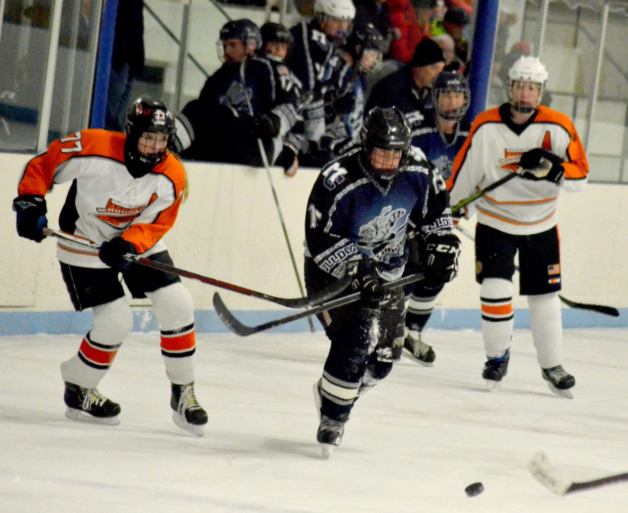 Corey Scranton pursues the puck during Moffat County Bulldogs' game against Hyland Hills.