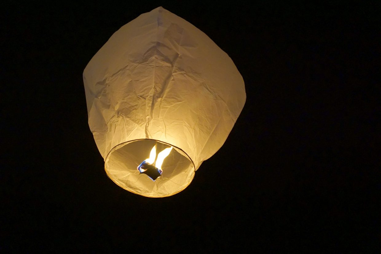 A paper lantern rises above Craig to honor a loved one lost but not forgotten.