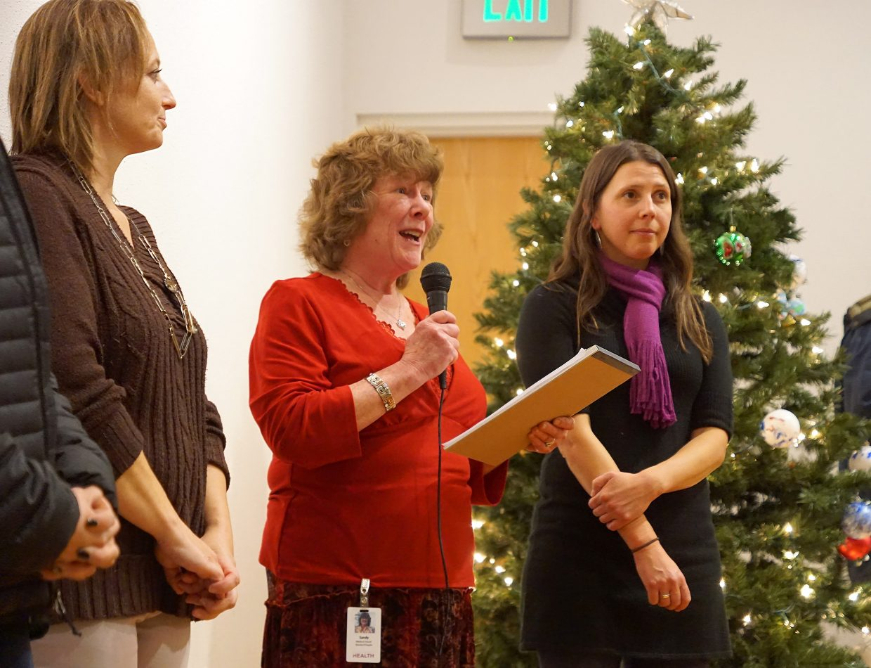 Chaplain Sandy Beran, center, of Northwest Colorado Health's Home Health and Hospice program offers comfort and a prayer, suggesting to those struggling with the loss of a loved one to