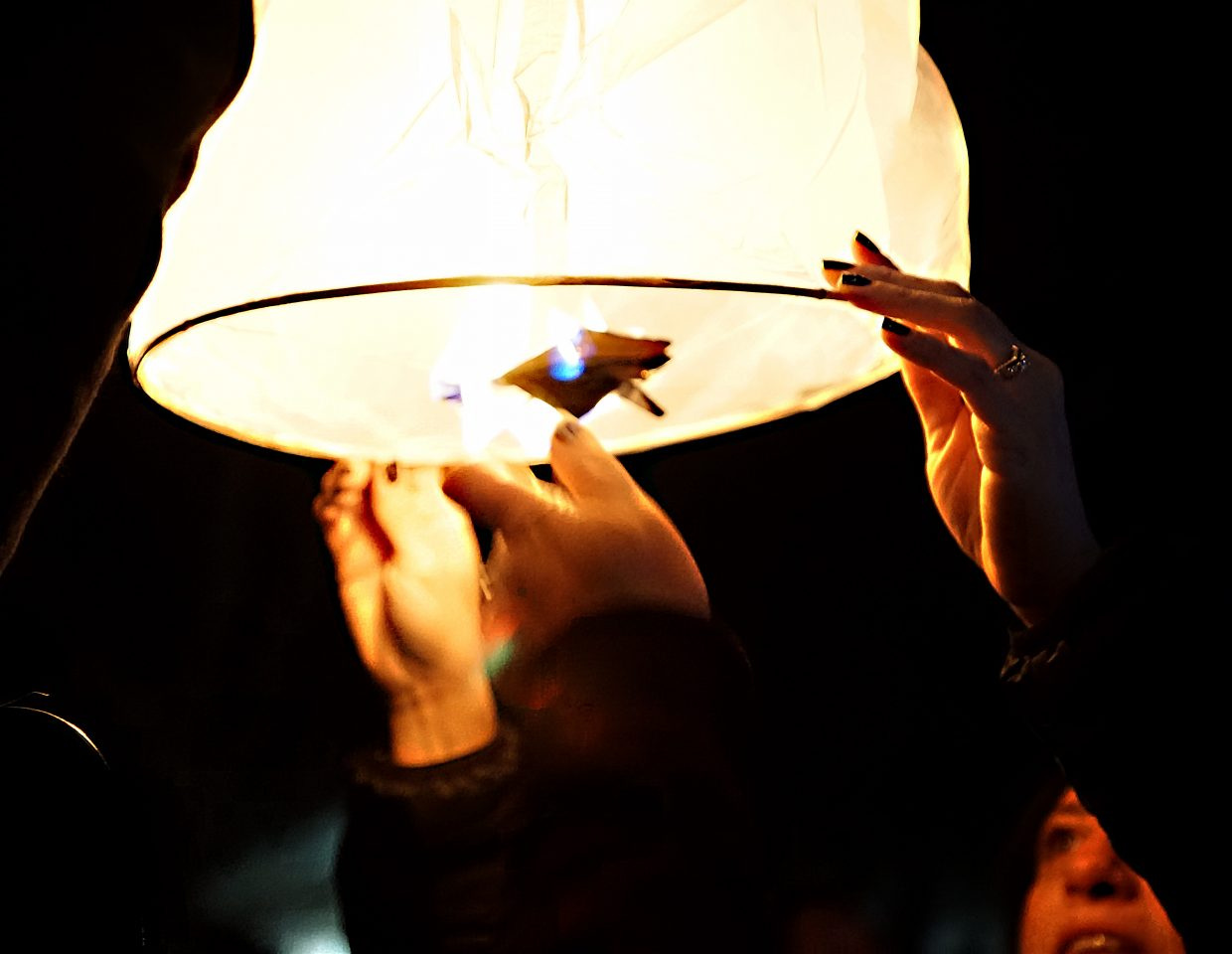 The four corners of the lantern's wick are lit.