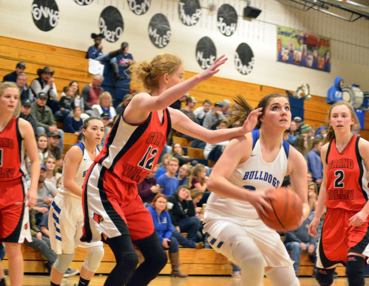 Moffat County High School's Jenna Timmer makes her move, cutting through the Grand Valley defense.