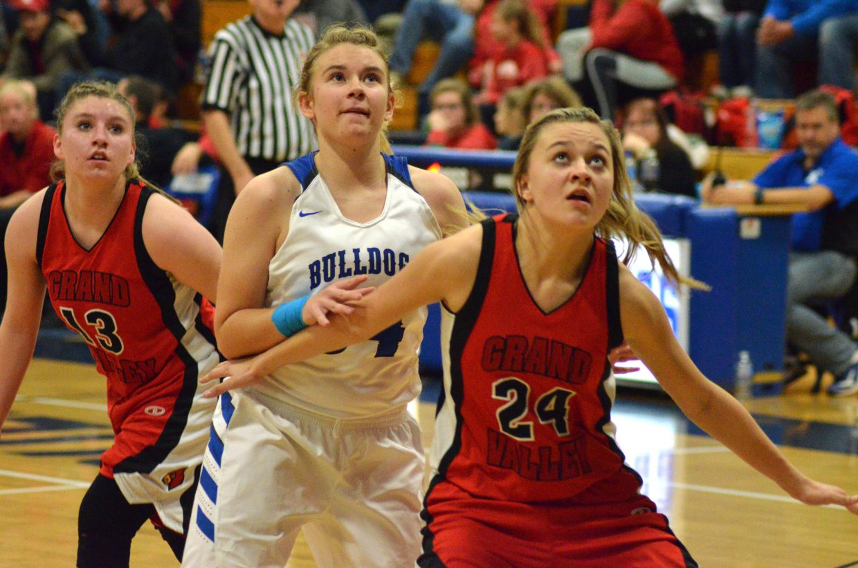 Moffat County High School's Brittnee Meats  fights for a rebound.